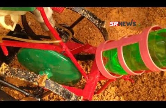 Seed sowing machine made by child