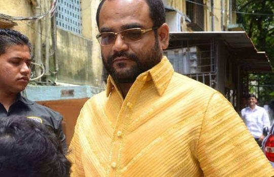 Man in Golden Shirt